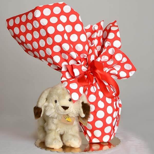 uovo di pasqua al cioccolato fondente con peluche coniglietto